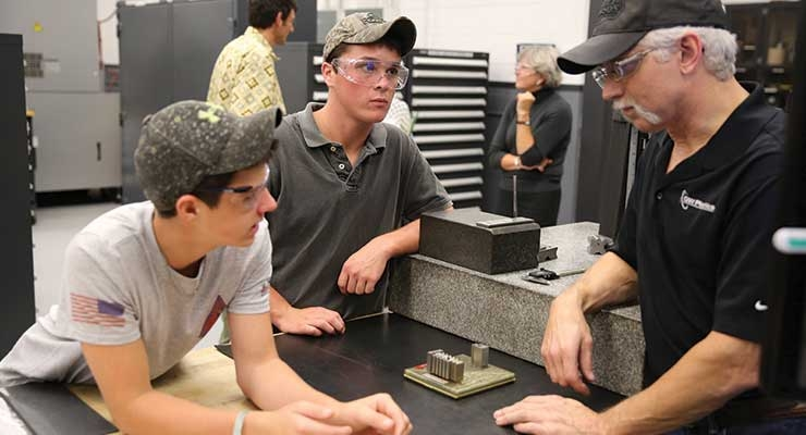 Local Vermont high school students studying at the GW Plastics School of Tech learn about advanced tooling and molding. Image courtesy of GW Plastics.