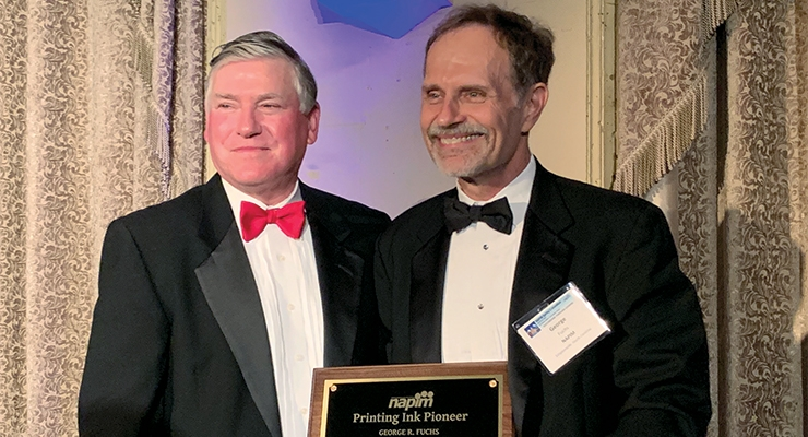 George Fuchs, right, receives the 2019 NAPIM Printing Ink Pioneer Award from NAPIM president Jim Leitch.