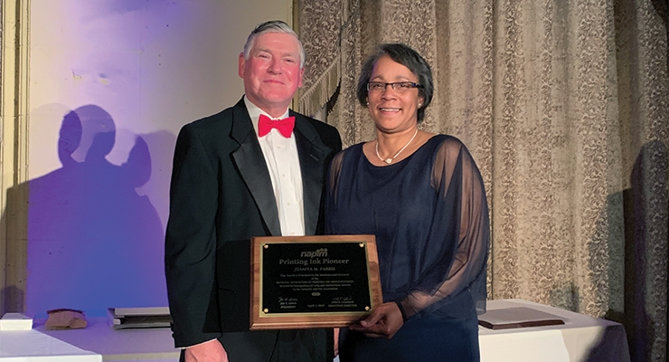 Dr. Juanita Parris, right, receives the 2019 NAPIM Printing Ink Pioneer Award from NAPIM president Jim Leitch.