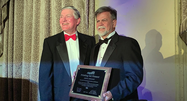 John Sergeant, right, receives the 2019 NAPIM Printing Ink Pioneer Award from NAPIM president Jim Leitch.