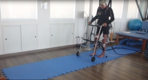 Brain-Controlled, Non-Invasive Muscle Stimulation Allows Chronic Paraplegics to Walk