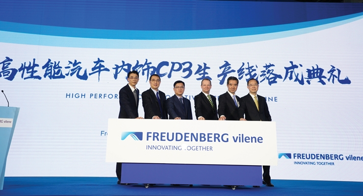 Freudenberg & Vilene executives gather at the opening of the  new production line for car headliners in Suzhou, China.