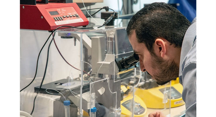 Doctoral student Mohamed Gamal uses a newly developed cell encapsulation device. Image courtesy of UBC Okanagan.
