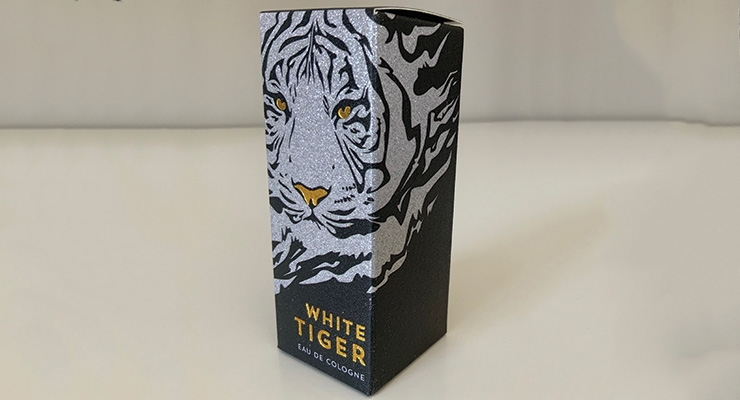 White Tiger Eau de Cologne's carton is made with Harmony Paper Company's Diamond Print Glitter, and it is recyclable.