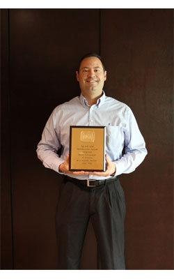 Harper Corp. honored for 20 years with TLMI