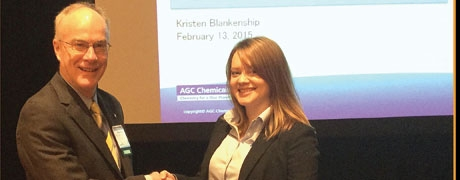 Dr. Robson Storey, chairman of the Symposium presents Kristen Blankenship with the Best Paper Award.